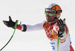 Photo - Canada's Jan Hudec celebrates after finishing the men's super-G to win the bronze medal at the Sochi 2014 Winter Olympics, Sunday, Feb. 16, 2014, in Krasnaya Polyana, Russia. (AP Photo/Gero Breloer)