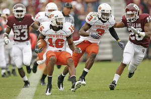Photo - Oklahoma State cornerback and return specialist Perrish Cox will not play in the Cotton Bowl on Saturday after a violation of team rules. OSU officials didn't specify what rule he violated and said they would have no further comment. OKLAHOMAN ARCHIVE PHOTO