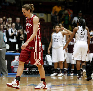 Photo - OU's Carlee Roethlisberger (10) walks off the court after OU's loss in the women's college basketball Big 12 Championship tournament game between the University of Oklahoma and Texas A&M in Kansas City, Mo., Friday, March 11, 2011.  Photo by Bryan Terry, The Oklahoman