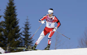Photo - Norway's gold medal winner Marit Bjoergen skis during the women's cross-country 15k skiathlon at the 2014 Winter Olympics, Saturday, Feb. 8, 2014, in Krasnaya Polyana, Russia. (AP Photo/Lee Jin-man)
