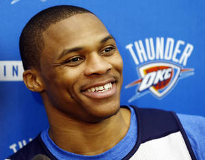 Photo - Russell Westbrook speaks during media availability after practice for the Oklahoma City Thunder NBA basketball team in Oklahoma City, Wednesday, April 23, 2014. Photo by Nate Billings, The Oklahoman