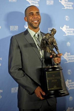 Photo - Tampa Bay Rays pitcher David Price poses for a photo with the Warren Spahn Award. Photo by Bryan Terry, The Oklahoman