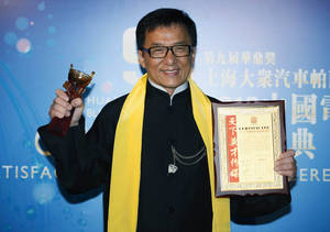 "Photo - FILE - In this Wednesday, April 10, 2013 file photo, Hong Kong movie star Jackie Chan poses after winning the Best Action Movie in China Award at the Huading Awards in Hong Kong. Chan has received a lot of awards during a career that's spanned 50 years. But a best director award is rare on his trophy shelves. The action star took home one Wednesday night for his 100th film, ""Chinese Zodiac."" (AP Photo/Kin Cheung, File)"