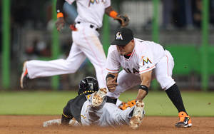 Photo - Pittsburgh Pirates left fielder Starling Marte, left,  steals second base as Miami Marlins second baseman Rafael Furcal, right, unable to tag  in the third inning of a baseball game on Friday, June 13, 2014, at Marlins Park in Miami. (AP Photo/El Nuevo Herald, David Santiago)