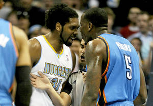 Photo - Nene, left, and Kendrick Perkins are separated during a game earlier this year in Denver. PHOTO COURTESY OF THE DENVER POST