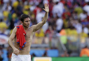 Photo - England's Frank Lampard waves to England fans after the group D World Cup soccer match between Costa Rica and England at the Mineirao Stadium in Belo Horizonte, Brazil, Tuesday, June 24, 2014.  The match ended in a 0-0 draw.  (AP Photo/Matt Dunham)
