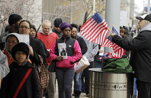 photo -   Voiters wait in line outside the Cuyahoga County Board of Elections in Cleveland on the final day of early voting Monday, Nov. 5, 2012. About 1.6 million people have voted early in Ohio. (AP Photo/Mark Duncan)