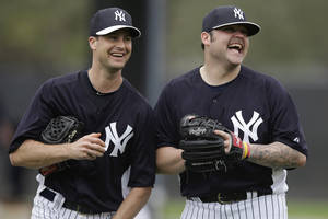 photo - New York Yankees' Joba Chamberlain, right, laughs with non-roster invitee Matt Daley during a workout at baseball spring training, Wednesday, Feb. 13, 2013, in Tampa, Fla. (AP Photo/Matt Slocum)