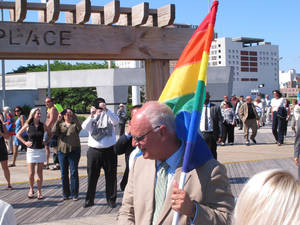 Photo - Atlantic City Mayor Don Guardian holds a flag in Atlantic City, N.J., Monday, June 16, 2014. Atlantic City is planning a series of events to attract gay tourists, who are becoming an increasingly important part of the resort's growth strategy. (AP Photo/Wayne Parry)