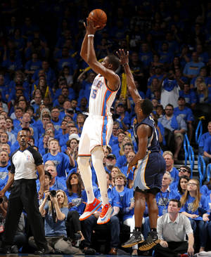 Photo - Oklahoma City's Kevin Durant (35) shoots in front of Memphis' Tony Allen (9) during Game 1 in the first round of the NBA playoffs between the Oklahoma City Thunder and the Memphis Grizzlies at Chesapeake Energy Arena in Oklahoma City, Saturday, April 19, 2014. Photo by Sarah Phipps, The Oklahoman