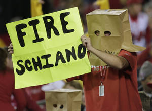 Photo - A Tampa Bay Buccaneers fan, wearing a paper bag, holds up a sign during the fourth quarter of an NFL football game against the Carolina Panthers, Thursday, Oct. 24, 2013, in Tampa, Fla. (AP Photo/Chris O'Meara)