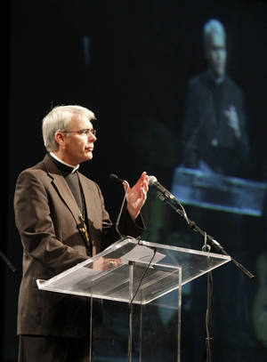 Photo - The Most Rev. Paul S. Coakley, archbishop of the Archdiocese of Oklahoma City, speaks Saturday at the Cox Convention Center in Oklahoma City. PHOTO BY PAUL HELLSTERN, THE OKLAHOMAN