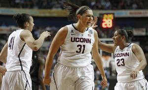 Photo - Connecticut center Stefanie Dolson (31) celebrates against Stanford during the first half of the semifinal game in the Final Four of the NCAA women's college basketball tournament, Sunday, April 6, 2014, in Nashville, Tenn. (AP Photo/John Bazemore)