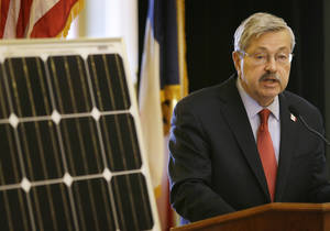Photo - FILE - In this April 9, 2014 file photo Iowa Gov. Terry Branstad speaks during the Iowa Solar and Small Wind Energy Trade Association Day at the Statehouse in Des Moines, Iowa. Branstad's administration surrendered a $1 million grant designed to make Iowa a nationwide leader in solar energy after electric utilities lobbied for major changes, emails show. (AP Photo/Charlie Neibergall, File)