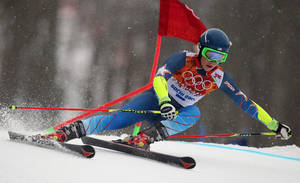 Photo - United States' Mikaela Shiffrin passes a gate in the first run of the women's giant slalom at the Sochi 2014 Winter Olympics, Tuesday, Feb. 18, 2014, in Krasnaya Polyana, Russia.(AP Photo/Alessandro Trovati)