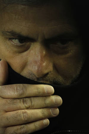 Photo - Real Madrid's coach Jose Mourinho from Portugal speaks to their players before their La Liga soccer match against Valencia at the Mestalla stadium in Valencia, Spain, Sunday, Jan. 20, 2013. (AP Photo/Alberto Saiz)