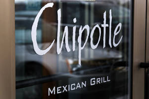 Photo - FILE - This Tuesday, Jan. 28, 2014, file photo, shows the door at a Chipotle Mexican Grill in Robinson Township, Pa. On Tuesday, April 29, 2014, Chioptle Chief Financial Officer Jack Hartung noted that the chain doesn't currently charge a whole lot more for its steak filling, even though beef costs have climbed considerably. He says Chipotle will widen the price gap between steak and chicken. (AP Photo/Gene J. Puskar, File)