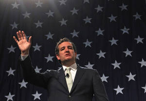 Photo - FILE - In this April 25, 2014, file photo, Republican U.S. Sen. Ted Cruz, of Texas,  addresses a crowd during a rally at the Western Republican Leadership Conference in Sandy, Utah. Cruz will visit Ukraine this month and meet with leaders of the protest movement that forced out the country's pro-Russian president, his office said Tuesday, May 13, 2014. (AP Photo/Rick Bowmer, File)