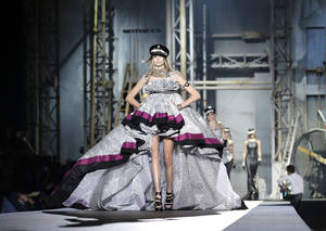 Photo -   A model wears a creation part of the DSquared2 women's Spring-Summer 2013 fashion collection, during the fashion week in Milan, Italy, Monday, Sept. 24, 2012. (AP Photo/Antonio Calanni)