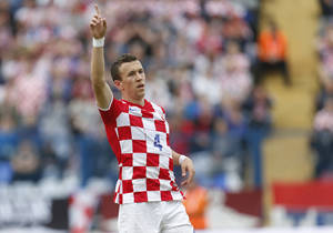 Photo - Croatia'sIvan Perisic celebrates his second goal during the internationa friendly soccer match between Croatia and Mali, in Osijek, Croatia, Saturday, May 31, 2014. (AP Photo/Darko Bandic)