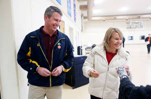 photo -   Republican U.S. Senate candidate Kurt Bills and his wife Cindy joke with an election official after they cast their ballots at Lutheran Church of Our Savior in Rosemount, Minn. Tuesday, Nov. 6, 2012. Bills faces Democratic Sen. Amy Klobuchar. (AP Photo/Minnesota Public Radio, Jeffrey Thompson)