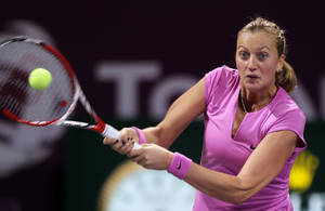 Photo - Petra Kvitova of the Czech Republic returns the ball to Venus Williams of the U.S. during the third day of the WTA Qatar Ladies Open in Doha, Qatar, Wednesday, Feb. 12, 2014. (AP Photo/Osama Faisal)