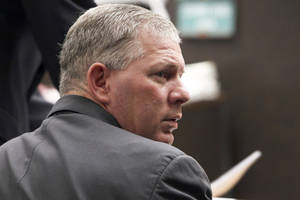 Photo - FILE - In this March 5, 2012 file photo, former New York Mets outfielder Lenny Dykstra is seen during his sentencing for grand theft auto in the San Fernando Valley section of Los Angeles. Dykstra filed a lawsuit Wednesday, April 2, 2014 saying he suffered an unprovoked and brutal beating by deputies in a Los Angeles County jail two years ago. The lawsuit also alleges that top officials at the jail tried to keep Dykstra from speaking out about the incident. (AP Photo/Nick Ut, File)