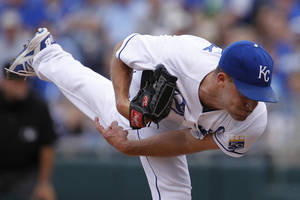 Photo - Kansas City Royals pitcher Danny Duffy throws to a batter in the first inning of a baseball game against the Los Angeles Dodgers at Kauffman Stadium in Kansas City, Mo., Tuesday, June 24, 2014.  (AP Photo/Colin E. Braley)