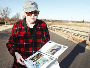 photo - Bird watcher Susy Hall looks through her field identification book she created of birds in Mitch Park, Tuesday, December 4, 2012.  Photo By David McDaniel/The Oklahoman