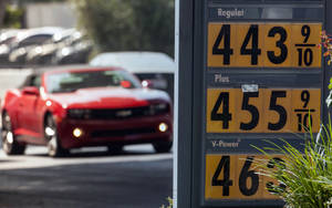 Photo -   Motorists drive past a gas station in Los Angeles Thursday, Oct. 4, 2012. Motorists in California paid an average of $4.232 per gallon Wednesday. That is 45 cents higher than the national average and exceeded only by Hawaii among the 50 states. (AP Photo/Damian Dovarganes)