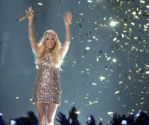 Photo -   Singer Carrie Underwood performs at the 2012 CMT Music Awards on Wednesday, June 6, 2012 in Nashville, Tenn. (Photo by John Shearer/Invision/AP)