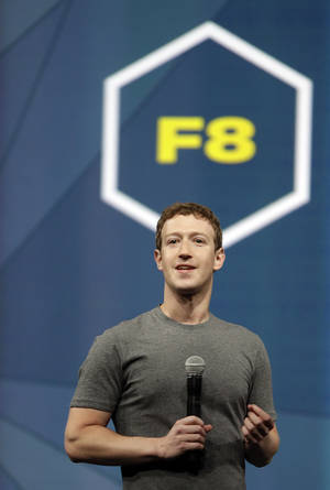Photo - Facebook CEO Mark Zuckerberg gestures while delivering the keynote address at the f8 Facebook Developer Conference Wednesday, April 30, 2014, in San Francisco. (AP Photo/Ben Margot)