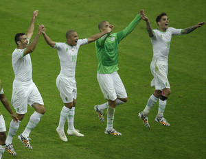 Photo - Members of the Algerian soccer team join hands as they celebrate after winning 4-2, the group H World Cup soccer match between South Korea and Algeria at the Estadio Beira-Rio in Porto Alegre, Brazil, Sunday, June 22, 2014. (AP Photo/Michael Sohn)