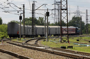 Photo - A refrigerated train loaded with bodies of the passengers of Malaysian Airlines flight MH17 departs Kharkiv railway station, Ukraine, Tuesday, July 22, 2014. The train carrying the remains of people killed in the Malaysia Airlines crash arrived in the eastern Ukrainian city of Kharkiv on Tuesday on their way to the Netherlands, a journey which has been agonizingly slow for relatives of the victims. (AP Photo/ Sergei Chizavkov)