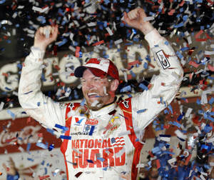Photo - Dale Earnhardt Jr. celebrates in Victory Lane after winning the NASCAR Daytona 500 Sprint Cup series auto race at Daytona International Speedway in Daytona Beach, Fla., Sunday, Feb. 23, 2014. (AP Photo/Terry Renna)