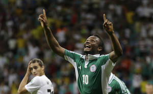 Photo - FILE - In this June 20, 2013, file photo, Nigeria's John Obi Mikel celebrates scoring his side's first goal during the soccer Confederations Cup group B match between Nigeria and Uruguay at Fonte Nova stadium in Salvador, Brazil. After impressing on their way to the second round in each of their first two FIFA World Cup appearances, 1994 and 1998, Nigeria have struggled since: going out at the group stage three times while taking just two points from their last eight matches in the finals. (AP Photo/Natacha Pisarenko, File)