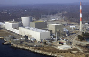 Photo - FILE - This March 18, 2003 aerial file photo shows the Millstone nuclear power facility in Waterford, Conn. The nuclear plant is preparing to ask federal regulators for permission to use water that's even warmer than the temperature that forced it to shut a unit in August 2012. (AP Photo/Steve Miller, File)