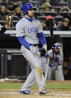 Photo - Chicago Cubs' Ryan Kalish flips his bat after striking out during the fifth inning of Game 2 of an interleague baseball doubleheader against the New York Yankees, Wednesday, April 16, 2014, at Yankee Stadium in New York. (AP Photo/Bill Kostroun)