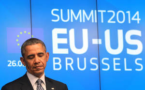 Photo - U.S. President Barack Obama looks down as he addresses the media at the European Council building in Brussels, on Wednesday, March 26, 2014. U.S. President Barack Obama is on a one day trip to Belgium to meet EU officials and visit the WWI Flanders Field Cemetery. (AP Photo/Yves Logghe)