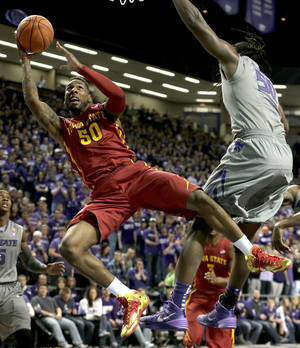 Photo - Iowa State's DeAndre Kane (50) gets past Kansas State's D.J. Johnson, right, to put up a shot during the first half of an NCAA college basketball game Saturday, March 1, 2014, in Manhattan, Kan. (AP Photo/Charlie Riedel)