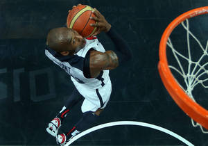 Photo -   Kobe Bryant of the United States goes up for a slam dunk against Nigeria during a men's basketball preliminary round match at the 2012 Summer Olympics on Thursday, Aug. 2, 2012, in London. (AP Photo/Christian Petersen, Pool)