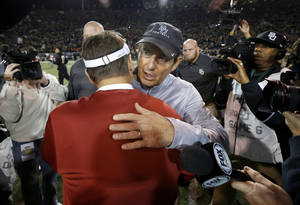 Photo - Baylor coach Art Briles greets Oklahoma coach Bob Stoops after an NCAA college football game between the University of Oklahoman (OU) Sooners and the Baylor Bears at Floyd Casey Stadium in Waco, Texas, Thursday, Nov. 7, 2013. Baylor won 41-12. Photo by Bryan Terry, The Oklahoman