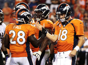 Photo - Denver Broncos quarterback Peyton Manning (18) greets teammate Montee Ball (28) as time expires in an NFL football game against the Baltimore Ravens, Thursday, Sept. 5, 2013, in Denver. The Broncos won 49-27. (AP Photo/Joe Mahoney)
