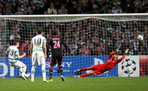 Photo - Celtic's James Forrest, left, scores from a penalty past Ajax's goalkeeper Jasper Cillessen, right, during their Champions League Group H soccer match at Celtic Park, Glasgow, Scotland, Tuesday Oct. 22, 2013. (AP Photo/Scott Heppell)