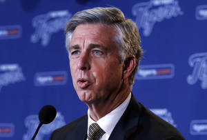 Photo - FILE - In this Dec. 4, 2013, file photo, Detroit Tigers general manager Dave Dombrowski answers a question at a news conference in Detroit. Dombrowski might be the most recognizable general manager in baseball. The Tigers begin another season among the favorites in the AL, owing much of their success to an executive who has remained at the top of his profession. (AP Photo/Paul Sancya, File)