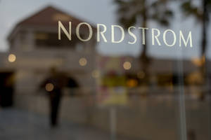 Photo - This May 9, 2013 photo shows a Nordstrom sign at a shopping mall in Brea, Calif. Nordstrom is expected to report quarterly results on Thursday, Aug. 15, 2013. (AP Photo/Jae C. Hong)