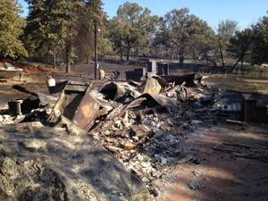photo - Burned trailer off Ettowah Road at 120th on Saturday morning. Photo by Steve Sisney.