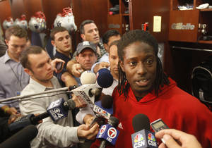 photo - FILE - This Sept. 26, 2012 file photo shows New England Patriots wide receiver Deion Branch responding to a reporter's question during a media availability in front of his locker at the NFL football team's facility in Foxborough, Mass. The Patriots have re-signed Branch for their battered corps of wide receivers. They signed him for the second time this season on Wednesday, Dec. 12, 2012. (AP Photo/Stephan Savoia, File)