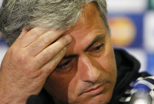 Photo - Chelsea's manager Jose Mourinho puts his hand to his forehead during a press conference at Stamford Bridge stadium in London, Tuesday, April 29, 2014. Chelsea will play in a Champions League semifinal second leg soccer match against Atletico Madrid on Wednesday. (AP Photo/Kirsty Wigglesworth)