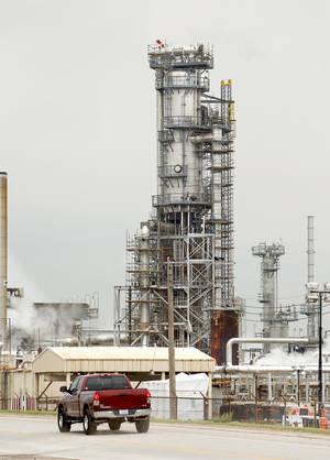 Photo - Scaffolding surrounds a tower Saturday at a Wynnewood refinery. The refinery was the scene of an explosion Friday that killed a worker and injured another.  Photo by Steve Sisney, the Oklahoman